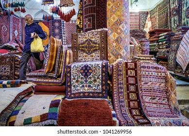 Shiraz, Iran - October 23, 2016: Traditional Iranian carpets and rugs for sale in a shop on the main bazaar in Shiraz city