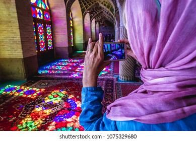Shiraz, Iran - October 23, 2016: Tourist in Nasir ol Molk Mosque also known as Pink Mosque, one of the most famous mosques in Shiraz