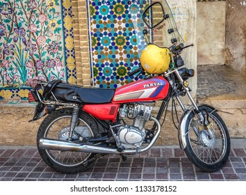 Shiraz, Iran - October 23, 2016: Parvaz motorcycle next to entrance to Vakil Bazaar in Shiraz
