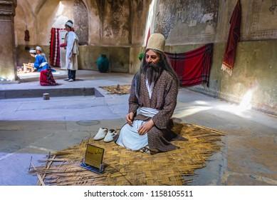 Shiraz, Iran - October 23, 2016: Figure of Dervish man in Vakil Bath, ancient bathouse in Shiraz