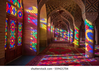 SHIRAZ, IRAN - OCTOBER 23, 2016 : Colorful light through stained glass window inside Nasir Al-Mulk Mosque (Pink Mosque), a traditional mosque in Shiraz, Iran.