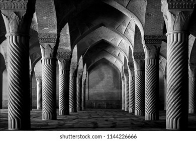 Shiraz, Iran - September 17, 2016: Ancient columns of the Vakil Mosque in Shiraz. Iran. Black and white image.