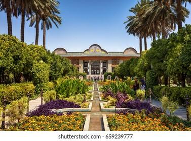 SHIRAZ, IRAN - SEPTEMBER 18, 2014: People visiting Persian garden of Narenjestan-e Ghavam and its historic pavilion. This garden is a landmark of Shiraz and very popular among tourists.