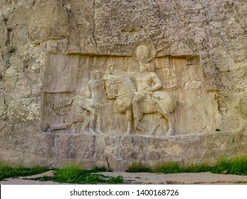 Shiraz, PERSEPOLIS, Naqsh-e Rustam, Iran.Rock relief of the triumph of Shapur I over the Roman emperors Valerian and Philip the Arab. Ancient city Persepolis- one of UNESCO World Heritage Sites.