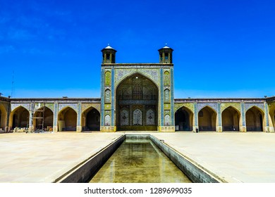 Shiraz Vakil Mosque Madrasa Blue Tiles Ornament Iwan and Pool with Two Minaret Towers