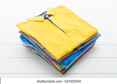 Shirt and Clothes on white wooden background