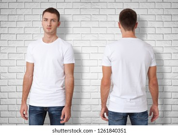 Shirt design and fashion concept - close up of man in blank white t-shirt front and rear. brick wall background.