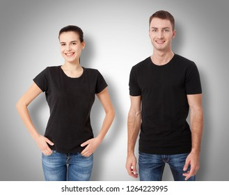 Shirt design fashion concept, close up of man and woman in blank black t-shirt isolated on grey background.