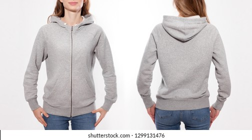 Shirt design and fashion concept - young woman in gray sweatshirt with zipper front and rear, gray hoodies, blank isolated on white background. mock up