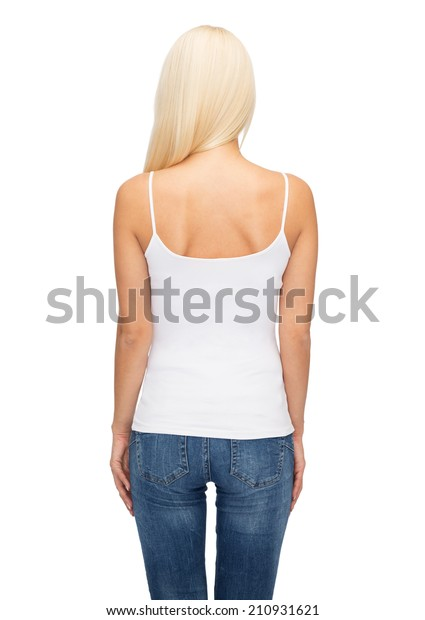 shirt design and people concept - young woman in blank white tank top from back