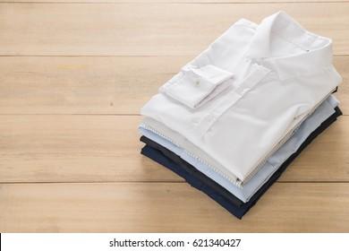 shirt fold stack on wood background