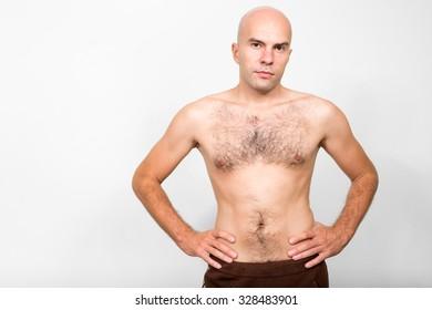 Shirtless bald man