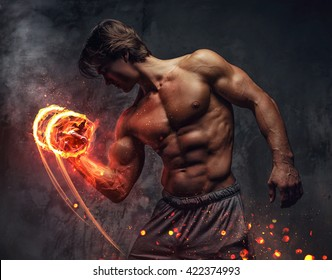Shirtless bodybuilder with burning dumbbell.