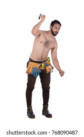 Shirtless dirty strong construction worker wearing brown jeans, safety boots and utility belt, he is holding a hammer. Isolated on white background.