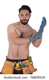 Shirtless dirty strong construction worker wearing brown jeans, utility belt and fitting a protective gloves. Isolated on white background.