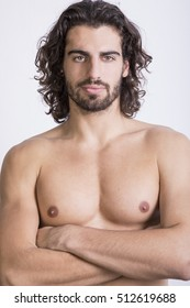 Shirtless man with long hair