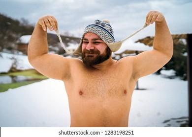 Shirtless man in winter day