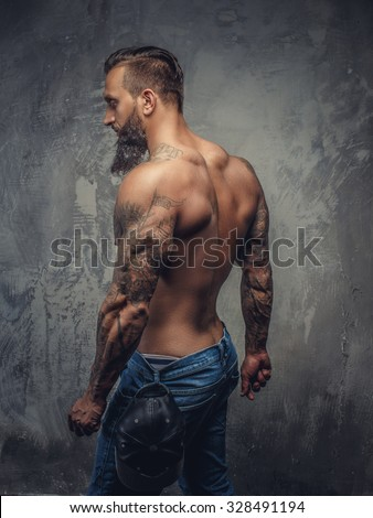 78d75212 Shirtless muscular guy from back in blue jeans with tattooed hands.
