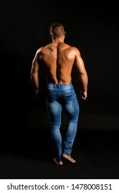 Shirtless muscular male rearview shot
