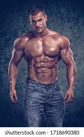 Shirtless Muscular Men in Jeans. Bodybuilder wearing Jeans