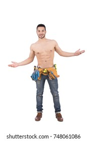 Shirtless strong builder wearing a utility belt. Isolated on white background.