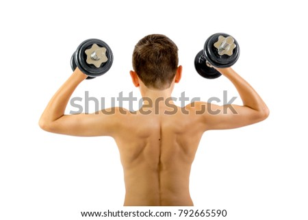 Shirtless teenage boy exercising with dumbbells isolated on a white background