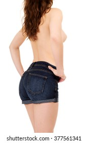 Shirtless woman in jeans shorts.