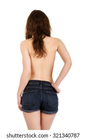 Shirtless young woman in jeans shorts.
