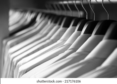 Shirts hanging stack on rack,close up