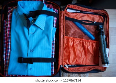 shirts layed down flat in suitcase viewed from top