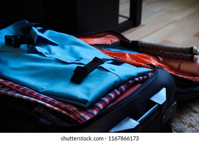 Shirts layed down flat in a travel case