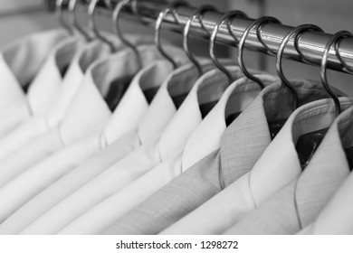 Shirts on hangers at the show, shallow DOF, b&w version