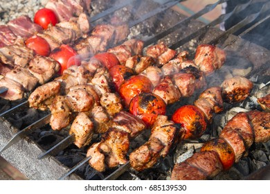 Shish kebab and fried meat on charcoal
