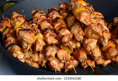 Shish kebab in a frying pan. Street trade on a city holiday.