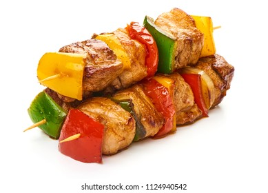 Shish Kebab - grilled meat skewers and vegetables BBQ, isolated on white background. Close-up.