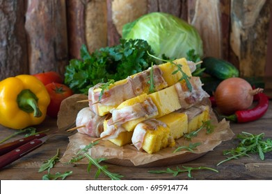 Shish kebab from polenta in bacon, the original recipe for a picnic