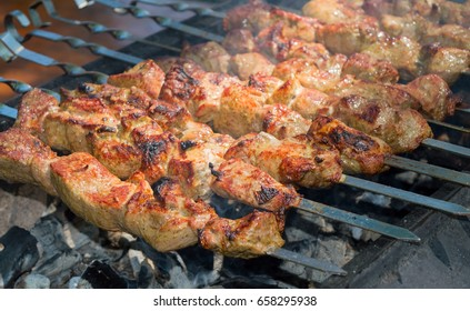 Shish kebab roasting on the grill