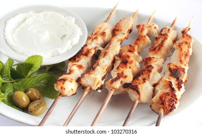 Shish taouk - Chicken shish kebab on white platter