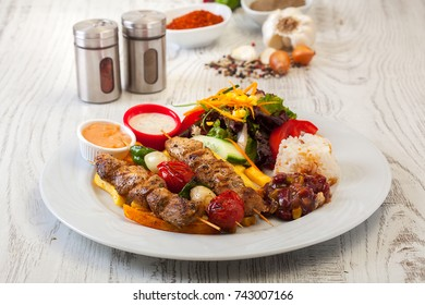 Shish taouk - Chicken shish kebab on white platter, Main dish for Turkish Restaurant  in Special Sauce - Tavuk Sis