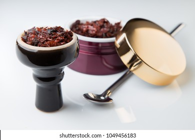 shisha with Apple flavor in a glossy black bowl, cooked for Smoking
