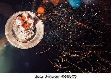 Shisha hookah with red hot coals. Sparks from breathe. Modern hookah with coconut charcoal for relax and shisha smoke. Hookah and sparks from coals. coal, hot, shisha, spark, hookah sparks