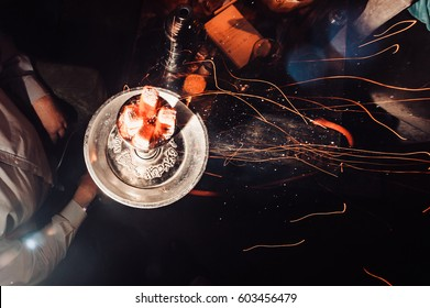 Shisha hookah with red hot coals. Sparks from breathe. Modern hookah with coconut charcoal for relax and shisha smoke. Hookah and sparks from coals. another wiew. shisha, sparks, spark, hookah sparks