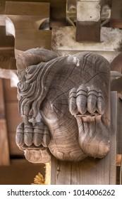 Shishi Lion and Baku (dream Eater),  wooden carved guardian of Hiruko Jinja or Ebisu Jinja shinto shrine. Located in Kamakura city near Namerigawa River in Komachi district.
