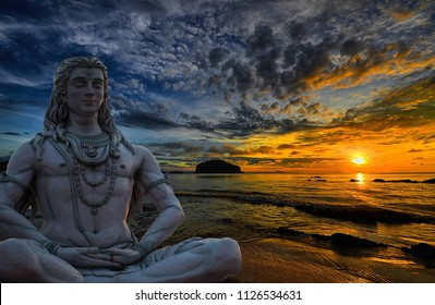 Shiva God statue in Rishikesh, India at sunset