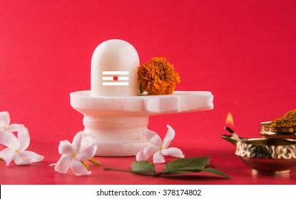 Shiva Linga decorated with flowers & bel patra and haldi kumkum for Maha Shivaratri, a Hindu festival celebrated annually in honour of the god Shiva. Season's Greeting
