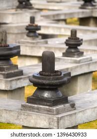 Shiva Lingam, Shiva Lingas stone wrapped around with the Tears of Shiva (Rudraksha) at meditation maze to practice walking meditation in Dhulikhel, Nepal