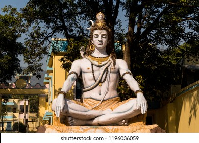 Shiva Statue in Rishikesh, India. God Shiva sits in a Lotus position and meditates.