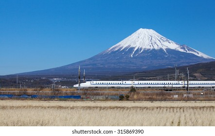 Shizuoka - JAN 13: Shinkansen bullet train passed Mt. Fuji at Fuji city  in JAN 13 ,2015 , Shizuoka ,Japan. Shinkansen is world's busiest high-speed railway operated by four Japan Railways companies.