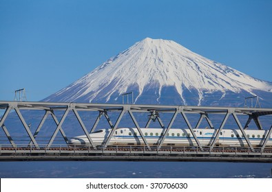 Shizuoka - JAN 13: Shinkansen bullet train and Mountain Fuji on JAN 13 ,2015 , Shizuoka ,Japan. Shinkansen is world's busiest high-speed railway operated by four Japan Railways companies.