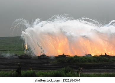 Shizuoka, Japan - August 18, 2007:Japan Ground Self-Defense Force Armoured fighting vehicles firing smoke grenades.